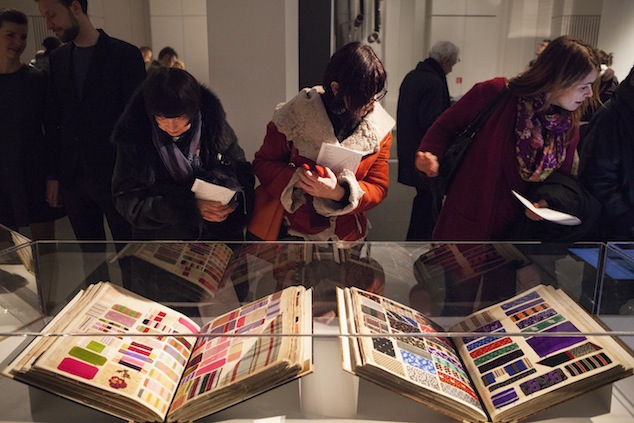 Visitors admiring the Abraham swatch books at Silks & Prints from the Abraham Archive - Couture in Colour, 2013, Photo: Boy Kortekaas