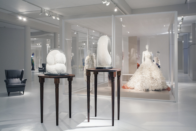 Kate MccGwire, Stifle, 2009 and Preen, 2013, Mixed media with dove and white pigeon feathers in antique glass domes at the Birds of Paradise: Plumes & Feathers exhibition, MoMu Fashion Museum Antwerp, Photo: Boy Kortekaas