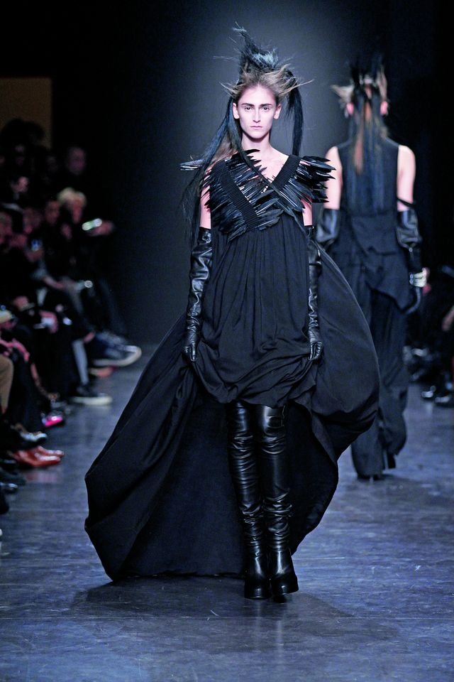 Ann Demeulemeester A/W 2011-2012. Silhouette with painted duck feathers pictured as ammunition in an ammunition holder. PHOTO: BVBA32