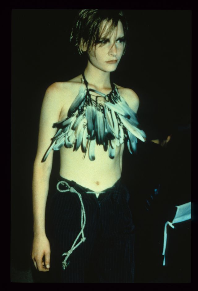Ann Demeulemeester S/S 1992. Kirsten Owen modeling a bustier made of dove feathers at the 1st Ann Demeulemeester catwalk show in Paris. Photo: Marleen Daniëls