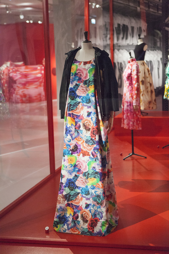 Coat with hood in manmade fi bre with zip fastener and rayon dress printed with flower patterns, predominantly roses, Jil Sander by Raf Simons, S/S 2011, (c) MoMu Photo: Boy Kortekaas